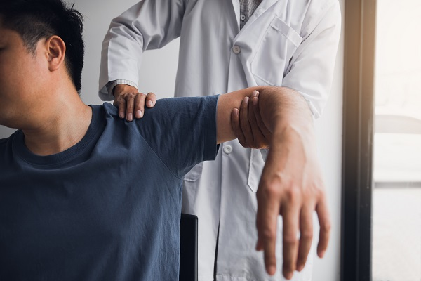 A man getting treatment from a doctor