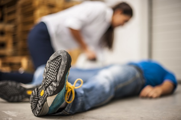 An injured worker on the ground