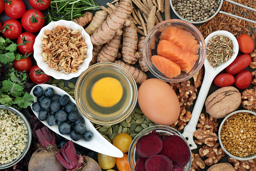 Food to promote brain power and memory concept with nuts, seeds, herbs, vegetables, fruit, dairy and fish. Top view.