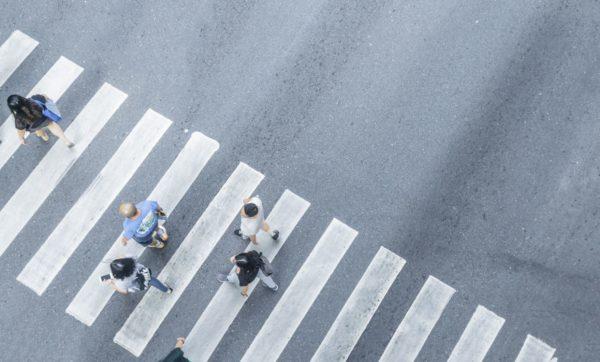 overhead view of pedestrians in a crosswalk